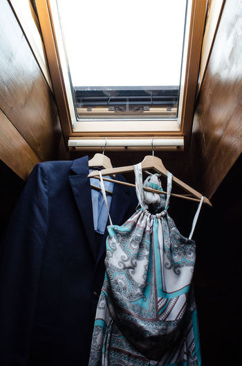 High angle view of clothes hanging on window at home