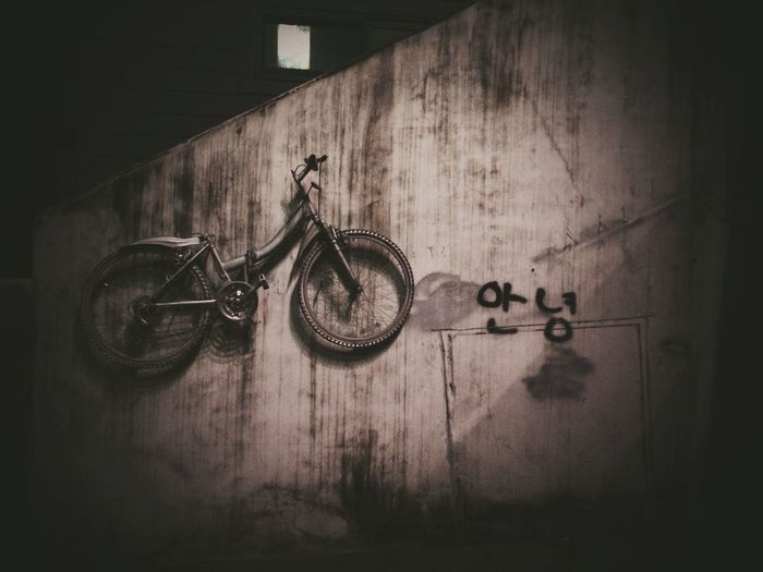 Close-up of bicycles on wall