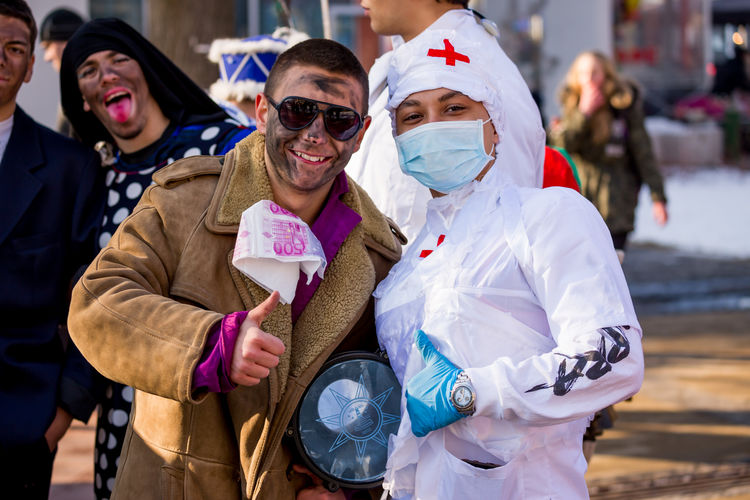 PERNIK, BULGARIA - JANUARY 26, 2018: Two artists teens with costumes of patient and nurse pose smiling for the camera at the annual International Festival of Masquerade Games Surva in Pernik, Bulgaria CostumeParty Nurse Pernik Bulgaria Bulgarian Folklore Celebration Costume Costume Party Costumes Day Focus On Foreground Happiness Lifestyles Looking At Camera Masquerade Men Outdoors People Portrait Real People Smile Smiles Smiling Surva Young Adult