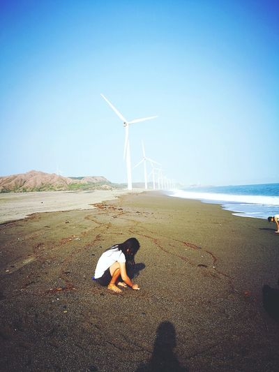 EyeEm Selects Wind Turbine Wind Power Sea Fuel And Power Generation Sand Beach Alternative Energy One Person Business Finance And Industry Sky Outdoors Industry Day Animal Themes Horizon Over Water Domestic Animals People Mammal Children Only Nature EyeemPhilippines Sommergefühle Colour Your Horizn
