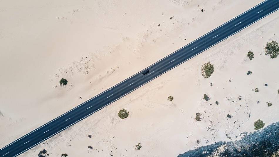Road trip 🚗🛣 Transportation Mode Of Transport Land Vehicle Live For The Story No People Nature Outdoors The Great Outdoors - 2017 EyeEm Awards Roadtrip Drone  Sand Dune Dunes Road Dronephotography Aerial View Street The Street Photographer - 2017 EyeEm Awards Beach Traveling Corralejo Vertical Shot Journey Lost In The Landscape Perspectives On Nature