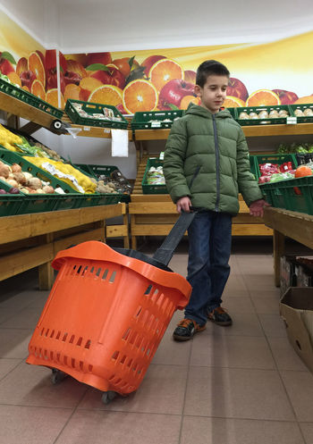 Child with a shopping car in a supermarket Supermarket Boy Child Vegetables Food Products Shop Fruits Buy Shopping