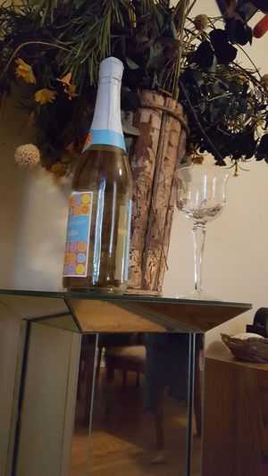 Table Indoors  No People Day Wood Floors Dried Flower bottle of wine wine glass Wine Not