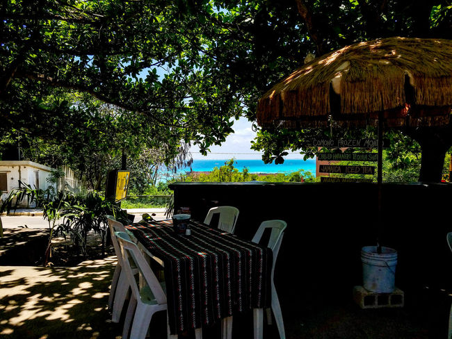 Chair No People Outdoors Tree Day Nature Sky Beauty In Nature Scenics Spring May 2017 Springtime Mexico Isla Mujeres Mexico Trapical Climate Blue Water Table Ocean Bar Restaurant Sign Bucket Unbrella Tablecloth Road The Week On EyeEm