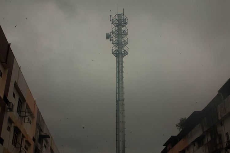 Dark Skies Raining Architecture Brooding Sky Building Exterior Built Structure City Dark Days Day Low Angle View Nature No People Outdoors Sky Telephone Tower