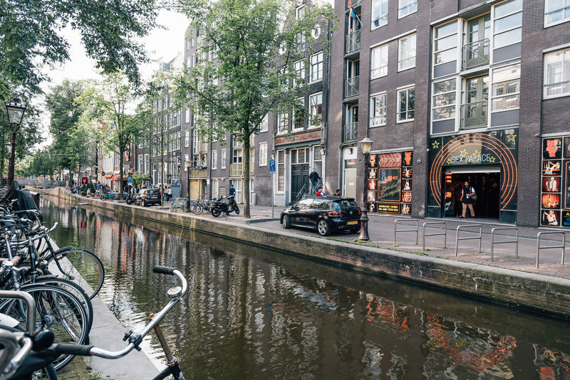 Amsterdam street scene. Red light District in Amsterdam Amsterdam Architecture Building Exterior Canals City City Life City Life Cityscape Cityscapes Day Large Group Of People Mode Of Transport Outdoors People Prostitution Red Light Distric Red Light District Street Street Life Transportation Tree