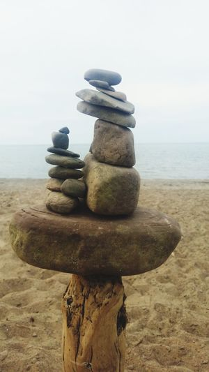 Stack Rock - Object Sea Sky Pebble Sunlight Relaxation Nature Outdoors Tranquil Scene No People Tranquility Beauty In Nature Day