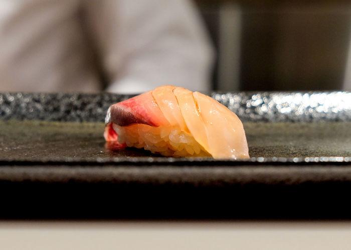 Fresh raw amberjack (kanpachi) fish from Kyushu, Japan at Yasu Sushi in Toronto, Canada. Dinner Japan Japanese Food Meal Raw Rice Sushi Amberjack Fish Kanpachi Plate Soy Sauce Sushi Bar Upclose