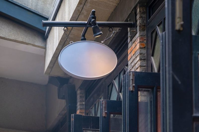 EyeEm Selects Low Angle View Architecture Lighting Equipment No People Built Structure Hanging Indoors  Window Circle Wall - Building Feature Ceiling Technology Close-up Electric Light Safety Day Directly Below Metal Geometric Shape Shape