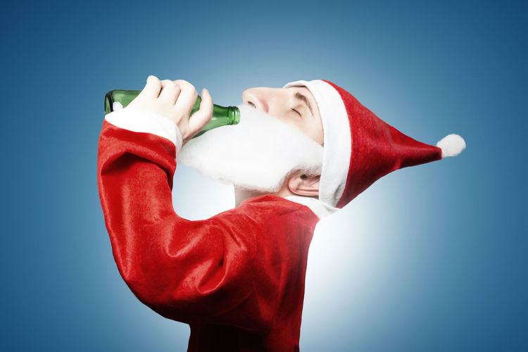 caricature of funny drunken santa claus drinking beer Beer Beer Bottle Celebration Christmas Drunk Drunken Happy Relaxing Santa Claus Winter Alcohol Alcoholic  Caricature Comic Costume Drinking Red