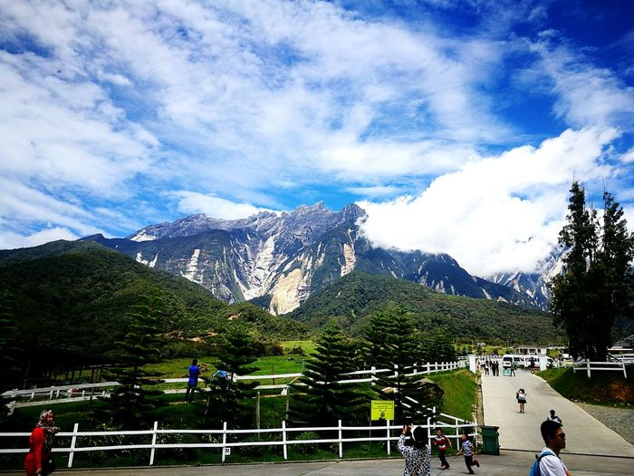Mount Kinabalu Mountain Sky Railing Men Cloud - Sky Mountain Range Leisure Activity Walking Incidental People Tranquil Scene Beauty In Nature Person Vacations Scenics Tranquility Nature Tourism Tourist Day Cloudy EyeEm Gallery EyeEmBestPics Beauty In Nature Kundasang, Ranau Sabah EyeEm Nature Lover
