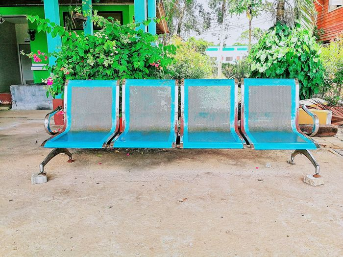 Empty chairs in swimming pool at yard