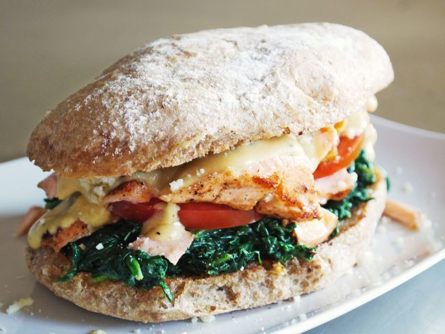 Homemade Bread Burger Close-up Day Fast Food Focus On Foreground Food Food And Drink Freshness Full Grain Bread Hamburger Healthy Eating Indoors  No People Plate Ready-to-eat Salmon Sandwich Serving Size Spinach Streetfood Tomato Slices