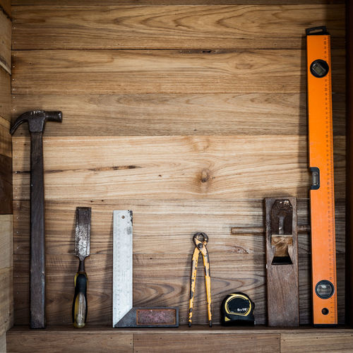 Work Tools On Wooden Shelf