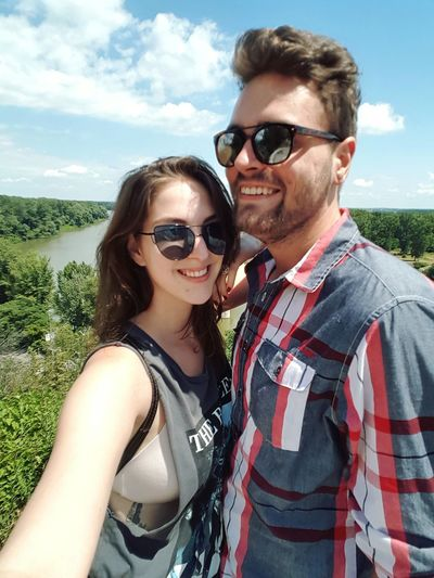 Sunglasses Two People Portrait Smiling Young Adult Young Women Adult Cloud - Sky Heterosexual Couple Togetherness Summer Adults Only People Looking At Camera Men Happiness Sky Women Young Men Vacations