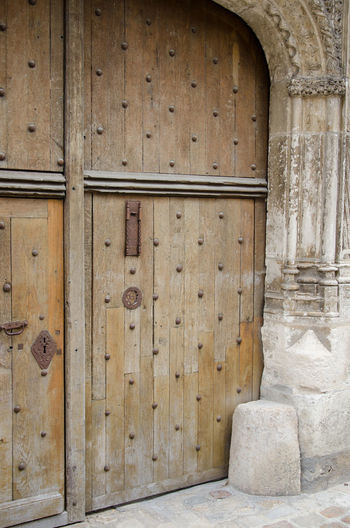 Architecture Building Building Exterior Built Structure Closed Column Day Door Entrance History Medieval Medieval Architecture No People Old Outdoors Pattern Protection Safety Security Solid The Past Wood - Material Civilization Historic Building Doorknob Doorway Keyhole Exterior Padlock Urban Scene
