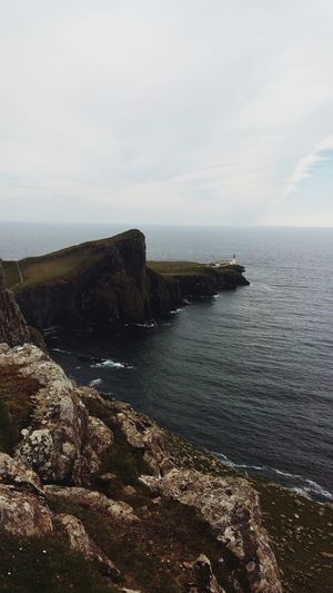 Scotland Neist Point Isle Of Skye Lighthouse Shore Water Sea Sky Scenics - Nature Beauty In Nature Tranquil Scene Horizon Over Water Tranquility Nature Land No People Horizon Day Rock Outdoors Idyllic Non-urban Scene