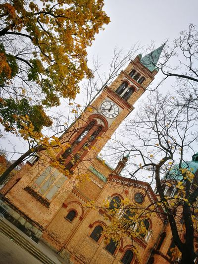 Low Angle View Built Structure Architecture Building Exterior Religion Day Tree Outdoors No People Place Of Worship Sky Skyscraper Nature City Close-up Austria History Clock Face Autumn Herbst Kirche City Vienna Favoriten