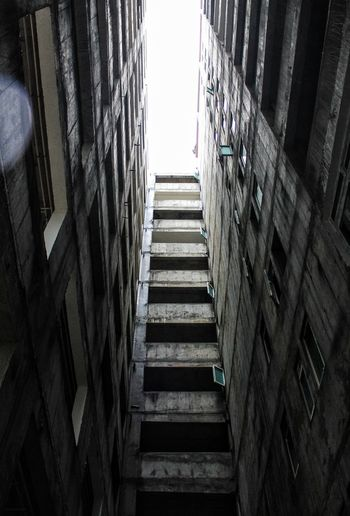 Architecture Built Structure Low Angle View Building Building Exterior No People Tall - High Window City Day Outdoors Industry Nature Clear Sky Pattern Wall Office Building Exterior Sunlight Wall - Building Feature Skyscraper Directly Below Apartment Concrete Alley