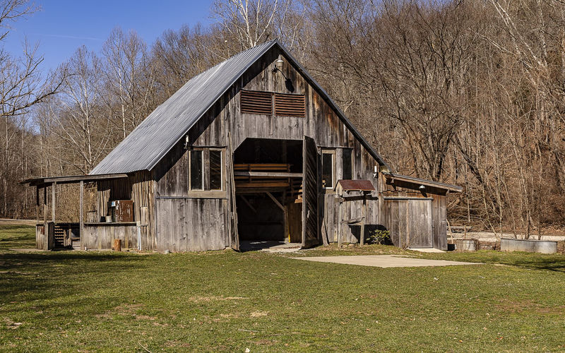 A beautiful wooden barn on a winter day. Architecture Built Structure Tree Building Exterior Grass Nature Day Landscape Building Field Bare Tree Agricultural Building Rural Scene Farm Outdoors Barns Country Scene Picturesque Countryside Country Life Americana Pastoral Winter Vintage