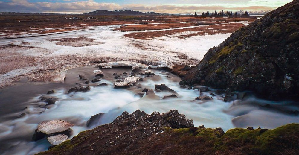 Scenic view of stream at pingvellir national park during winter