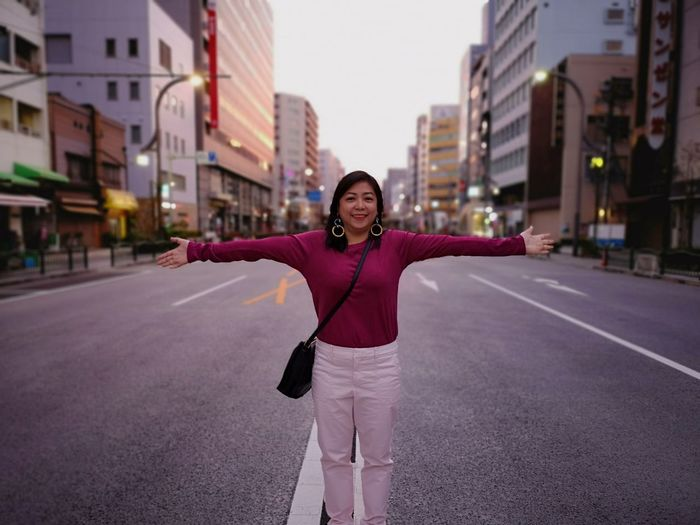 Embracing Work Life Empowered Autumn Wear Japan Empty Road Empty Places Commuter On The Way The Modern Professional City Portrait Young Women Smiling Looking At Camera Hailing Standing Women Cityscape City Life Capture Tomorrow