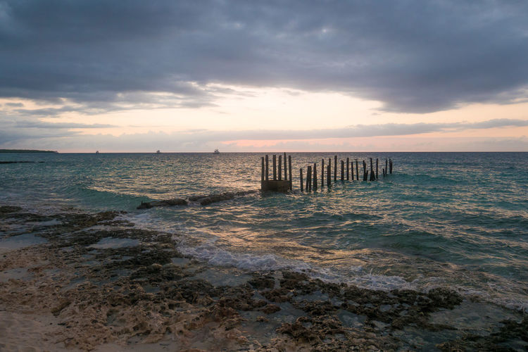 Cuba Beach Beauty In Nature Cloud - Sky Day Horizon Over Water Maria La Gorda Nature No People Outdoors Sand Scenics Sea Sky Sunset Tranquil Scene Tranquility Water Wave Wood - Material Wooden Post
