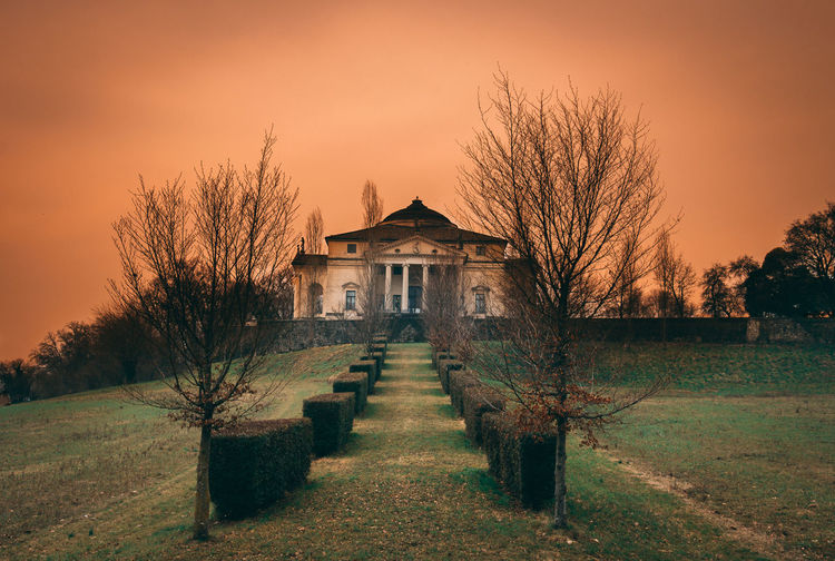 Villa La Rotonda - Vicenza, Italy realized by Andrea Palladio Architecture The Week on EyeEm Vicenza Italy Architecture Bare Tree Building Building Exterior Built Structure Field Grass House Land Landscape Nature No People Orange Color Outdoors Plant Residential District Scenics - Nature Sky Sunset Tranquility Tree Vicenza