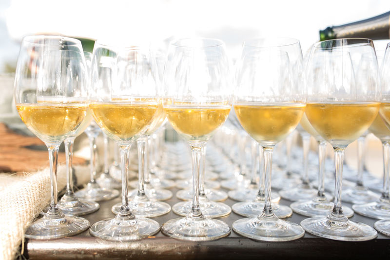 Wine being poured in wineglasses on table