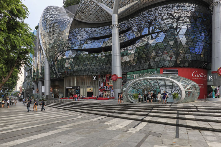 Singapore, Singapore - October 17, 2018: Day scene of ION Orchard shopping mall with several tourists walking by Singapore ASIA Gardens By The Bay Orchard Marina Bay Sands Flower Dome Cloud Forest Dome Arab Street Haji Lane, Singapore Modern Art Museum Ocean