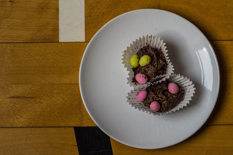 High angle view of cupcakes in plate on table