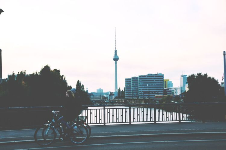 I can choose home. Discover Your City Frinds Capital Cities  Cityscape Cycling Bike Architecture City Building Exterior Built Structure Sky Bicycle Tower Transportation Travel Building Travel Destinations Mode Of Transportation Tourism Riding