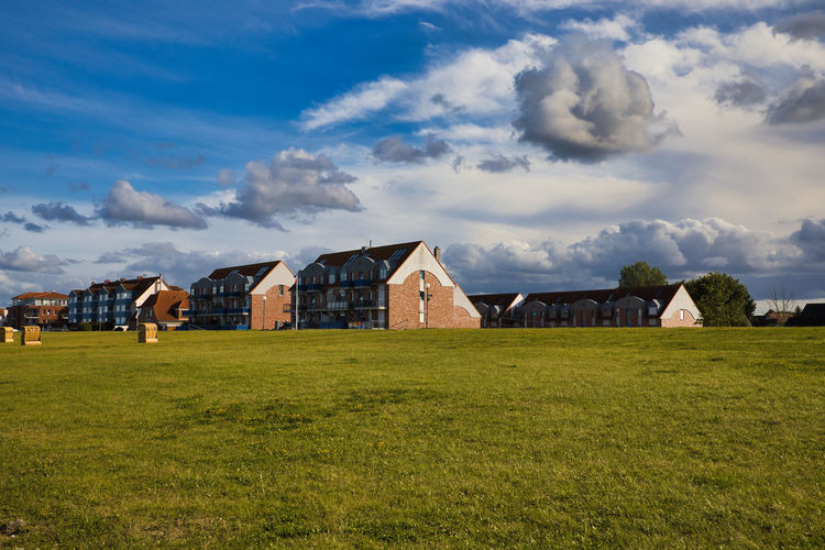 Houses on field against sky
