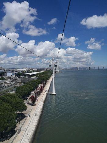 Day Cloud - Sky Outdoors Cable Sky Transportation Sea Tree Travel Destinations City Electricity Pylon Telephone Line