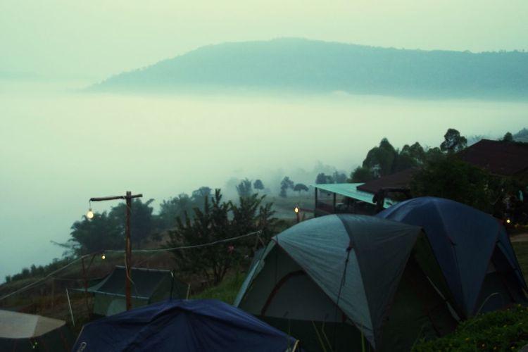 Tent on mountain against sky during rainy season