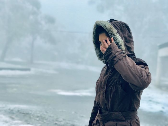 Man looking at camera during winter