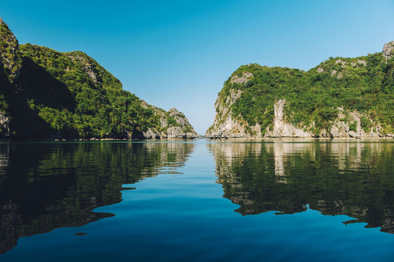 Halong Bay  Halongbay Kayaking Vietnam Beauty In Nature Blue Clear Sky Day Idyllic Lake Mountain Nature No People Outdoors Reflection Rocks Scenics Sky Tranquil Scene Tranquility Tree Water Waterfront