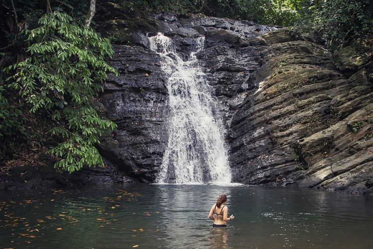 My daughter swimming near a waterfall in Domincalito, Costa RicaThe Great Outdoors - 2016 EyeEm Awards Waterfall Dominicalito Costa Rica Pura Vida Central America Exploring Hiking Adventures Adventure Waterfalls Water Sports Swimming Having Fun Check This Out The Essence Of Summer The Following Feel The Journey Original Experiences Been There. Done That. Lost In The Landscape