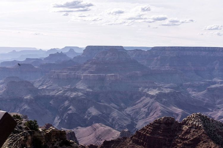 Scenic View Of Rocky Mountains Against Sky On Sunny Day At Grand Canyon National Park