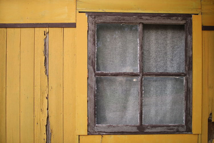Yellow Wood - Material Window Door Close-up Architecture Building Exterior Built Structure Weathered Peeling Off Padlock Door Knocker Latch Worn Out Keyhole Locked Lock Run-down Bad Condition Deterioration Peeled Closed Door Hope Love Lock Obsolete Damaged Safe Rusty Civilization Doorknob
