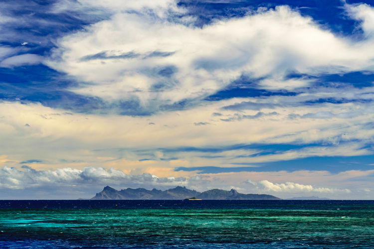 Beauty In Nature Blue Sky Cloud - Sky Colorful Colors Island Mountainous Island Nature Paradise Scenics Sea Sky Tranquil Scene Tranquility Tropical Turquoise Vacations Water