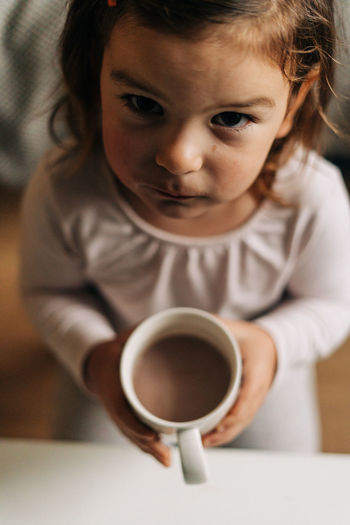 Close-up of girl drinking coffee