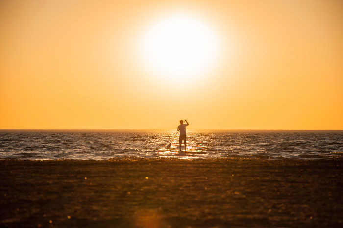 Alone Time Beach Epic Funsport Horizon Over Water Idyllic Majestic Nature Orange Color Paddlesurf Remote Scenics Sea Seascape Silhouette Silhouette Stand Up Paddling Standing Sun Sundowner Sunset Sup Tranquil Scene Tranquility Water