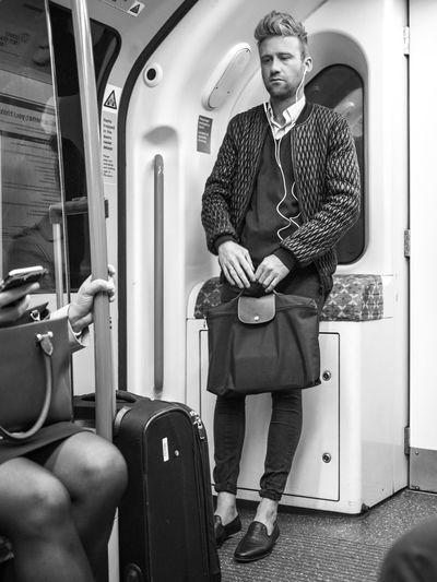 London underground, June 20, A passenger on the Victoria line does not look very happy Casual Clothing Commute Fashion Feel The Journey Hipster Lifestyles London Man Modern Monday Morning Portrait Traveling Tube Underground Victoria Line Young Young Adult Monochrome Photography London Lifestyle Black And White The Street Photographer - 2017 EyeEm Awards