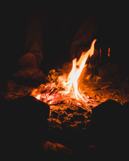 Sitting around the campfire Autumn Mood Flame Fire Heat - Temperature Fire - Natural Phenomenon Burning Night Wood Glowing Campfire Firewood Wood - Material Dark Orange Color Fall Beauty Autumn Motion Outdoor Adventure Camping Night Lights Travel Explore Burning Fire Pit
