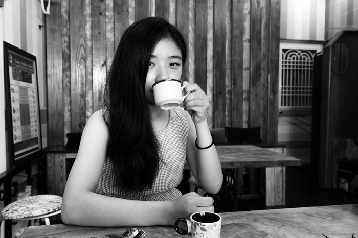 And a look at you when you're drinking my Coffee ☕️ One Person Indoors  Real People Leisure Activity Travel Destinations The Week On EyeEm Neverstopexploring  Travel Photography Exploring Asia Travelgram Travelblog Travelblogger Taiwan 🇹🇼 Taiwanese Girl Asian Market Coffee Cup Looking At Camera Bw Photography Blackandwhite Photography
