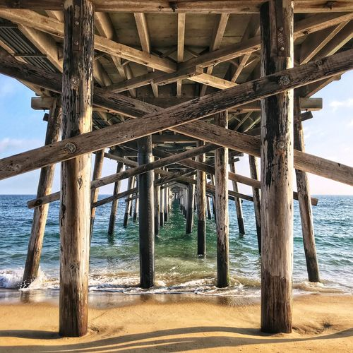 Balboa Pier Blue Columns Ocean Sand Lines Pier Balboa Pier Architecture Land Nature Wood - Material Day Underneath No People Sky Pier Outdoors Architectural Column