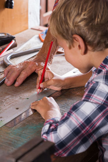 Boy working on table