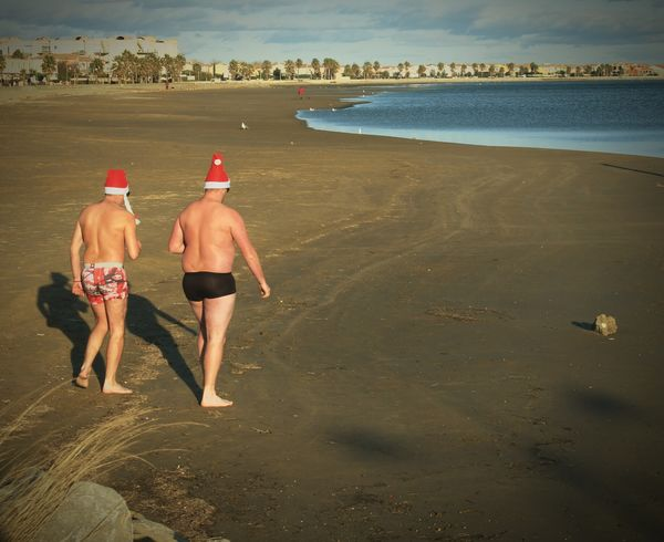 i saw this 2 guys the day of Christmas on a french beachin the southe of france. it was like a challenge between them! Two Is Better Than One Water Beach Sea Tourist Vacations Tourism Person Coastline Shore Summer Christmas Spirit Santaclaus The Culture Of The Holidays