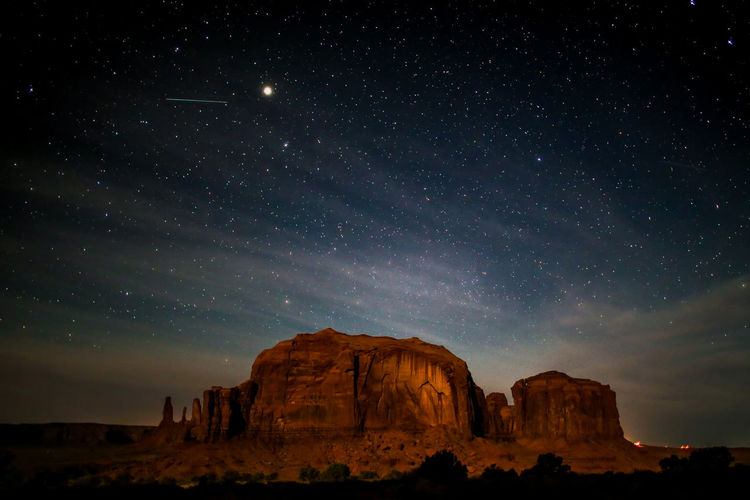 Desert Monument Valley Astronomy Beauty In Nature Environment Eroded Formation Galaxy Geology Nature Night Non-urban Scene Outdoors Physical Geography Rock Rock - Object Rock Formation Scenics - Nature Sky Space Star - Space Tranquility
